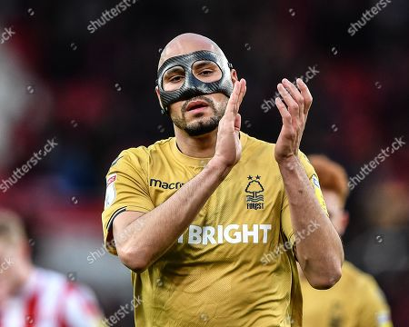 Yohan Benalouane (29) of Nottingham Forest applauds the Forest supporters