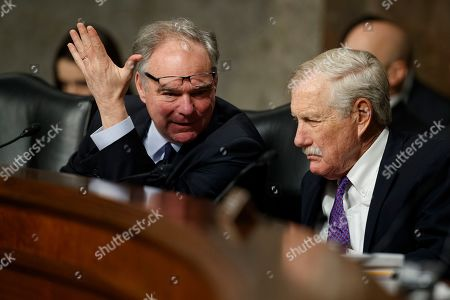 """Angus King, Tim Kaine. Senate Armed Services Committee members Sen. Tim Kaine, D-Va., left, and and Sen. Angus King, I-Maine, talk during a Senate Armed Services Committee hearing on """"Nuclear Policy and Posture"""" on Capitol Hill in Washington"""