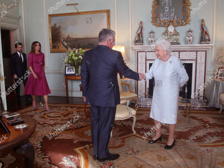 Queen Elizabeth II greets King Abdullah II of Jordan, ahead of Crown Prince Hussein of Jordan and Queen Rania, during a private audience at Buckingham Palace