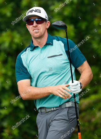 Hunter Mahan watches his shot as he tees off on the third hole during the first round of the Honda Classic golf tournament, in Palm Beach Gardens, Fla