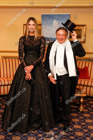 Elle Macpherson (L) and Austrian businessman Richard Lugner (R) pose for the media prior to the 63rd Vienna Opera Ball at the Grand Hotel in Vienna, Austria, 28 February 2019. Macpherson will accompany Austrian businessman Richard Lugner to the traditional Vienna Opera Ball later this evening.