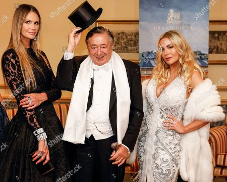 Elle Macpherson (L), Austrian businessman Richard Lugner (C) and his girlfriend Moni 'Rehlein' (R) pose for the media prior to the 63rd Vienna Opera Ball at the Grand Hotel in Vienna, Austria, 28 February 2019. Macpherson will accompany Austrian businessman Richard Lugner to the traditional Vienna Opera Ball later this evening.