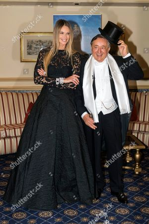 Model Elle McPherson and Austrian businessman Richard Lugner pose for the media during the presentation of her dress for this year's Opera Ball in Vienna, Austria