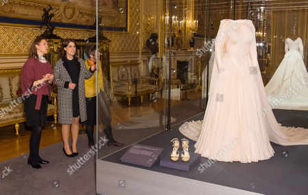 Princess Eugenie talks with Senior Curator Caroline De Guitaut as she views her evening wedding gown, part of a display of her wedding outfits in a new exhibition at Windsor Castle.