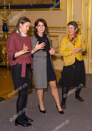 Princess Eugenie talks with Senior Curator Caroline De Guitaut and Head of Exhibitions Theresa-mary Morton during a viewing of a display of her wedding outfits in a new exhibition at Windsor Castle.