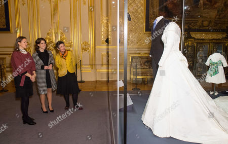 Stock Image of Princess Eugenie talks with Senior Curator Caroline De Guitaut and Head of Exhibitions Theresa-mary Morton as she views her wedding dress, part of a display of her wedding outfits in a new exhibition at Windsor Castle.