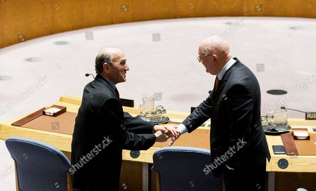 US Special Representative for Venezuela Elliott Abrams (L) and Vassily Nebenzia (R), Russian Ambassador to the United Nations, talk before the start of an United Nations Security Council meeting about the situation in Venezuela at United Nations headquarters in New York, New York, USA, 28 February 2019. The council was expected to vote on two resolutions related to Venezuela, one sponsored by the United States and one sponsored by Russia.