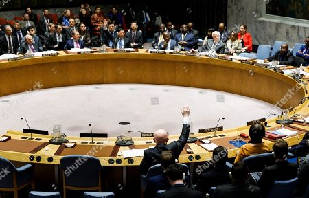 Vassily Nebenzia (C), Russian Ambassador to the United Nations, vetoes a draft resolution put forward by the United States in response to the situation in Venezuela during an United Nations Security Council at United Nations headquarters in New York, New York, USA, 28 February 2019. The council was expected to vote on two resolutions related to Venezuela, one sponsored by the United States and one sponsored by Russia.