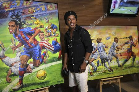Former Brazilian soccer player Ronaldinho Gaucho poses with several cartoons with his image at the Maracaná Stadium, in Rio de Janeiro, Brazil, 28 February 2019. Ronaldinho, world champion with Brazil in 2002, received a tribute at the emblematic Maracana Stadium, which inaugurated a tour dedicated to recalling the best moments of his career. On January 8, the legendary player left record of his footprints in the 'walk of fame' of the stadium.