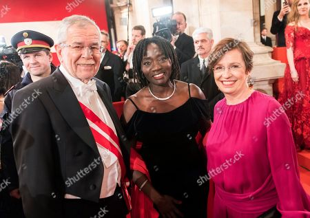 Austrian president Alexander Van der Bellen, Auma Obama and Doris Schmidauer, wife of Alexander Van der Bellen, from left, arrive for the traditional Opera Ball in front of the state opera in Vienna, Austria