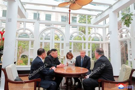 """Stock Image of Donald Trump, Kim Jong Un. Provided Friday, March 1, 2019, by the North Korean government, U.S. President Donald Trump, second from right, and North Korean leader Kim Jong Un, second from left, talk at a hotel in Hanoi, Vietnam. U.S. Sec. of State Mike Pompeo is at right. Kim Yong Chol, a North Korean senior ruling party official and former intelligence chief is at left. The content of this image is as provided and cannot be independently verified. Korean language watermark on image as provided by source reads: """"KCNA"""" which is the abbreviation for Korean Central News Agency"""