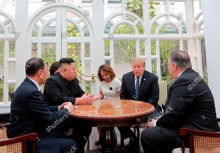Donald Trump, Kim Jong Un. In this, photo provided Friday, March 1, 2019, by the North Korean government, U.S. President Donald Trump, second from right, and North Korean leader Kim Jong Un, second from left, talk at a hotel in Hanoi, Vietnam. U.S. Sec. of State Mike Pompeo is at right. Kim Yong Chol, a North Korean senior ruling party official and former intelligence chief is at left. The content of this image is as provided and cannot be independently verified