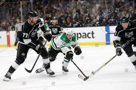 Stock Picture of Mattias Janmark, Jeff Carter, Dion Phaneuf. Dallas Stars' Mattias Janmark, center, is defended by Los Angeles Kings' Jeff Carter (77) and Dion Phaneuf, right, during the first period of an NHL hockey game, in Los Angeles