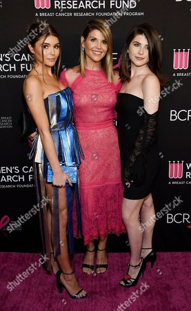 "Lori Loughlin, Isabella Rose Giannulli, Olivia Jade Giannulli. Actress Lori Loughlin, center, poses with daughters Olivia Jade Giannulli, left, and Isabella Rose Giannulli at the 2019 ""An Unforgettable Evening"" at the Beverly Wilshire Hotel, in Beverly Hills, Calif"