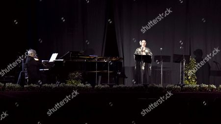 Stock Picture of Spanish pianist Antonio Lopez Serrano (L) and Spanish soprano Montserrat Marti Caballe (R) perform during a concert tribute to late Spanish opera singer Montserrat Caballe in Motril, Spain, 28 February 2019. Caballe died 06 October 2018 at the age of 85 years old.