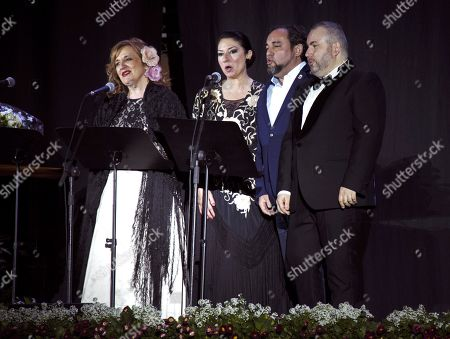 Stock Image of Spanish mezzo-soprano Beatriz Gimeno (L), soprano Montserrat Marti Caballe (2-L), Sports city councilor for Motril, Miguel Angel Munoz (2-R), and baritone Luis Santana (R) perform during a concert tribute to late Spanish opera singer Montserrat Caballe in Motril, Spain, 28 February 2019. Caballe died 06 October 2018 at the age of 85 years old.