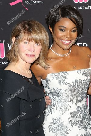 Kate Capshaw (L) and Gabrielle Union (R) arrive for the Women's Cancer Research Fund's (WCRF) 'An Unforgettable Evening' at a hotel in Beverly Hills, California, USA, 28 February 2019.