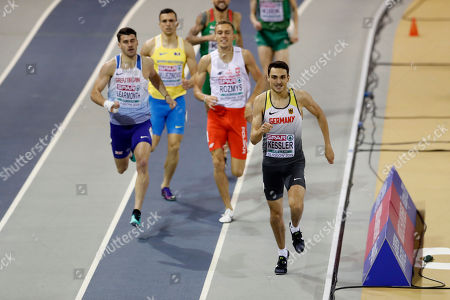 Stock Photo of Germany's Christoph Kessler, right, runs to qualify in a heat of the men's 800 meters race during the European Athletics Indoor Championships at the Emirates Arena in Glasgow, Scotland
