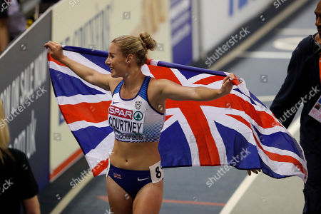 Bronze medalist Melissa Courtney of Britain holds a flag after the women's 3000 meters race final during the European Athletics Indoor Championships at the Emirates Arena in Glasgow, Scotland