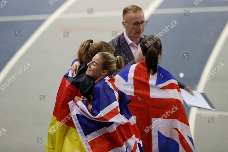 Bronze medalist Melissa Courtney, center, of Britain hugs silver medalist Konstanze Klosterhalfen, left, of Germany, next to Gold medalist Laura Muir of Britain after the women's 3000 meters race final during the European Athletics Indoor Championships at the Emirates Arena in Glasgow, Scotland