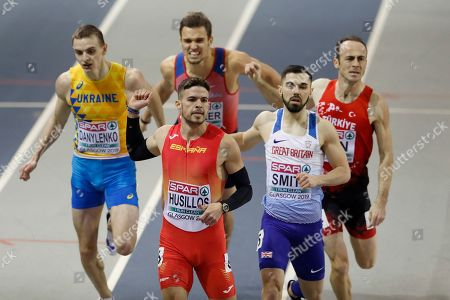 Stock Picture of Spain's Oscar Husillos, front left, and Britain's Owen Smith, front right, run to qualify from the second heat of the men's 400 meters race during the European Athletics Indoor Championships at the Emirates Arena in Glasgow, Scotland