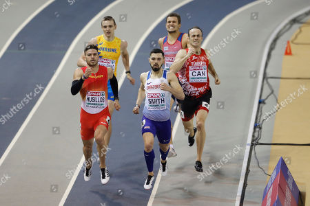 Spain's Oscar Husillos, front left, and Britain's Owen Smith, front center, run to qualify from the second heat of the men's 400 meters race during the European Athletics Indoor Championships at the Emirates Arena in Glasgow, Scotland