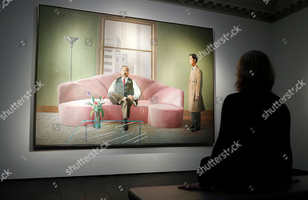 A Christie's employee looks at David Hockney's painting, Henry Geldzahler and Christopher Scott, painted in 1969, at Christie's auction house in London, . The acrylic on canvas painting is estimated to sell for 30 million pounds sterling ($39million) as part of the Post-War and Contemporary Art sale