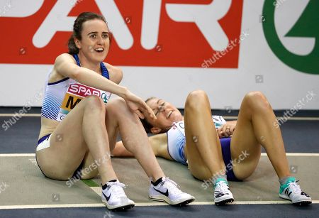Gold medalist Laura Muir and bronze medalist Melissa Courtney, right, both of Britain, smile after finishing the women's 3000 meters race final at the European Athletics Indoor Championships at the Emirates Arena in Glasgow, Scotland