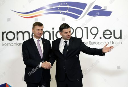 Vice-President of the European Comission Andrus Ansip (L) is welcomed by Romanian Minister of Communications and Information Society Alexandru Petrescu (R) at the Informal Meeting of EU Telecom Ministers (TTE) in Bucharest, Romania, 01 March 2019. According to official reports the agenda will focus on artificial intelligence and the Digital Single Market Strategy after 2020.