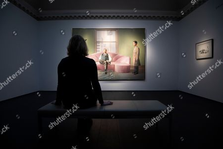 A Christie's employee poses next to a painting, entitled 'Henry Geldzahler and Christopher Scott' (1969), by British artist David Hockney during a press view at Christie's auction house in London, Britain, 01 March 2019. The artwork will go under the hammer as part of Christie's Post-War and Contemporary Art sale on 06 March.
