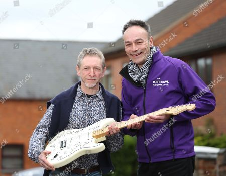 Stock Image of When Dave Allen's Cherished Signed Guitar Went Missing In The Post A Decade Ago He Gave Up Hope Of Ever Seeing The £20 000 Item Again Until It Turned Up On Ebay Recently. Dave Allen Left With Andy Goss Of The Charity Rainbows Which Will Be The Recipients When The Guitar Is Auctioned Off.