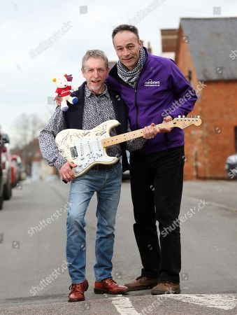 Editorial image of When Dave Allen's Cherished Signed Guitar Went Missing In The Post A Decade Ago He Gave Up Hope Of Ever Seeing The £20 000 Item Again Until It Turned Up On Ebay Recently. Dave Allen Left With Andy Goss Of The Charity Rainbows Which Will Be The Recip
