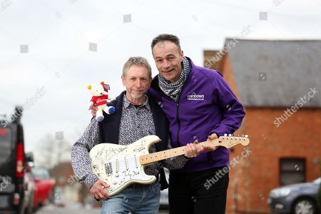 Editorial photo of When Dave Allen's Cherished Signed Guitar Went Missing In The Post A Decade Ago He Gave Up Hope Of Ever Seeing The £20 000 Item Again Until It Turned Up On Ebay Recently. Dave Allen Left With Andy Goss Of The Charity Rainbows Which Will Be The Recip