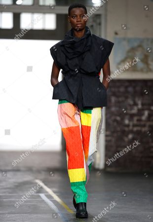 Stock Picture of A model presents a creation from the Fall/Winter 2019/20 Women collection by Japanese designer Yoshiyuki Miyamae for Issey Miyake fashion house during the Paris Fashion Week, in Paris, France, 01 March 2019. The presentation of the Women's collections runs from 25 February to 05 March.