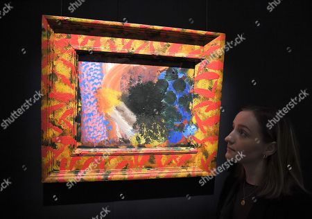 A Sotheby's employee next to a painting by  Howard Hodgkin, entitled Counting the Days