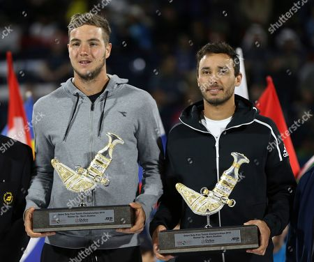 Ben McLachlan, Jan-Lennard Struff. Japan's Ben McLachlan, right, and his partner Germany's Jan-Lennard Struff hold their second place trophies after they were beaten by purav raja and Jeevan Nedunchezhiyan from India in their semifinal match at the Dubai Duty Free Tennis Championship, in Dubai, United Arab Emirates