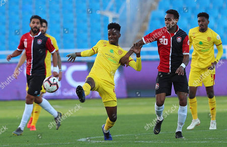 Al-Qadisiyah player Hatem Bilal (C-L) in action for the ball with Al-Raed player Kano (C-R) during the Saudi Arabia Professional League soccer match between  Al-Raed and Al-Qadisiyah at King Abdullah Sport City Stadium, Buraidah, Saudi Arabia, 01 March 2019.