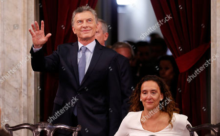 Stock Image of Mauricio Macri, Gabriela Michetti. Accompanied by Vice President Gabriela Michetti, right, Argentina's President Mauricio Macri waves as he arrives to deliver his State of the Nation speech that marks the opening 2019 session of Congress, in Buenos Aires, Argentina
