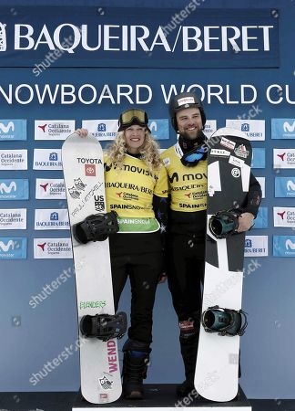 Lindsey Jacobellis (L) of the US and Martin Noerl (R) of Germany celebrate on the podium their leadership in their general categories at the FIS Snowboard Cross World Cup at Baqueira Beret, Catalonia, north eastern Spain, 02 March 2019.