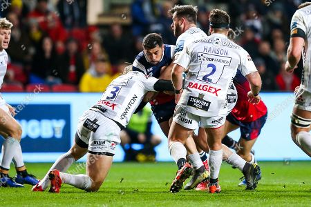 Charles Piutau of Bristol Bears is tackled by Billy Twelvetrees of Gloucester Rugby