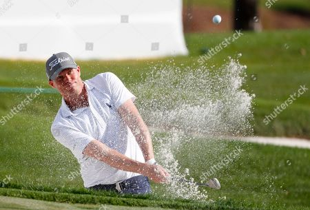 Nick Watney hits out of a bunker on the 10th hole during the second round of the Honda Classic golf tournament, in Palm Beach Gardens, Fla