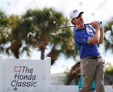 Stock Image of Roberto Castro watches his shot on the fourth hole during the second round of the Honda Classic golf tournament, in Palm Beach Gardens, Fla