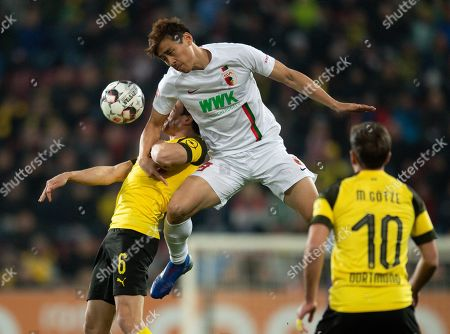 Ja-Cheol Koo of Augsburg (R) in action with Thomas Delaney of Dortmund during the German Bundesliga soccer match between FC Augsburg and Borussia Dortmund in Augsburg, Germany, 01 March 2019.