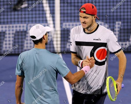 Stock Image of Ben McLachlan, Jan-Lennard Struff. Japan's Ben McLachlan, left, and his partner Germany's Jan-Lennard Struff celebrate after they defeated Purav Raja and Jeevan Nedunchezhiyan from India during their semifinal match at the Dubai Duty Free Tennis Championship, in Dubai, United Arab Emirates