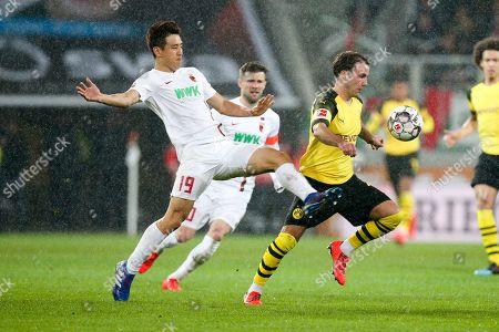 Ja-Cheol Koo #19 (FC Augsburg) and Mario Goetze #10 (Borussia Dortmund), FC Augsburg vs. Borussia Dortmund, Football, 1.Bundesliga, 01.03.2019, DFL REGULATIONS PROHIBIT ANY USE OF PHOTOGRAPHS AS IMAGE SEQUENCES AND/OR QUASI-VIDEO