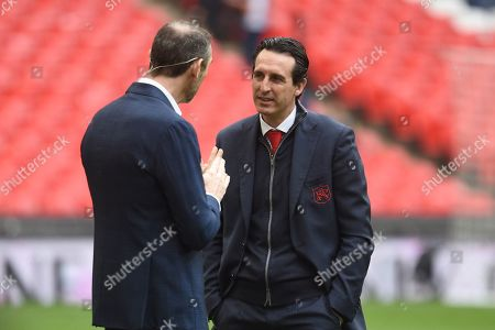 Arsenal manager Unai Emery talking to Martin Keown during the Premier League match between Tottenham Hotspur and Arsenal at Wembley Stadium, London
