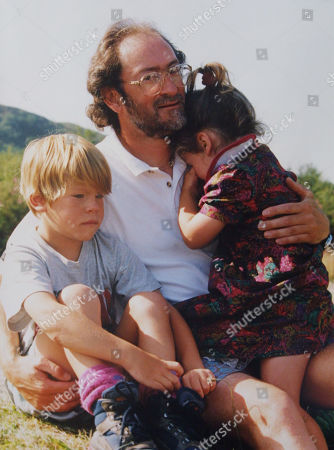 Jim Ballard with his children Tom Ballard and Kate Ballard after hearing of the death of his wife Alison Hargreaves who had been climbing K2