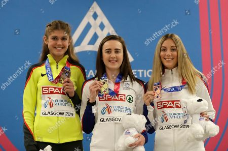 Britain's gold medalist Laura Muir, center, bronze medalist Melissa Courtney, right, of Britain and Germany's silver medalist Konstanze Klosterhalfen, left, smile during an awarding ceremony for the women's 3000 meters race at the European Athletics Indoor Championships at the Emirates Arena in Glasgow, Scotland