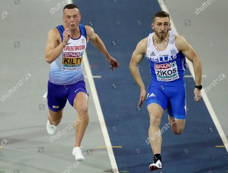 Britain's Richard Kilty, left, and Greece's Konstadinos Zikos, right, compete in a semifinal of the men's 60 meters race during the European Athletics Indoor Championships at the Emirates Arena in Glasgow, Scotland