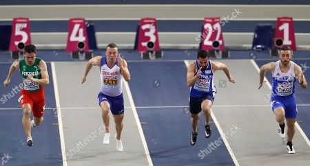 Portugal's Carlos Nascimento, left, Britain's Richard Kilty, 2nd left, Cyprus' Andreas Hadjitheoris, 2nd right, and Greece's Konstandinos Zikos, right, compete in a heat of the men's 60 meters race during the European Athletics Indoor Championships at the Emirates Arena in Glasgow, Scotland